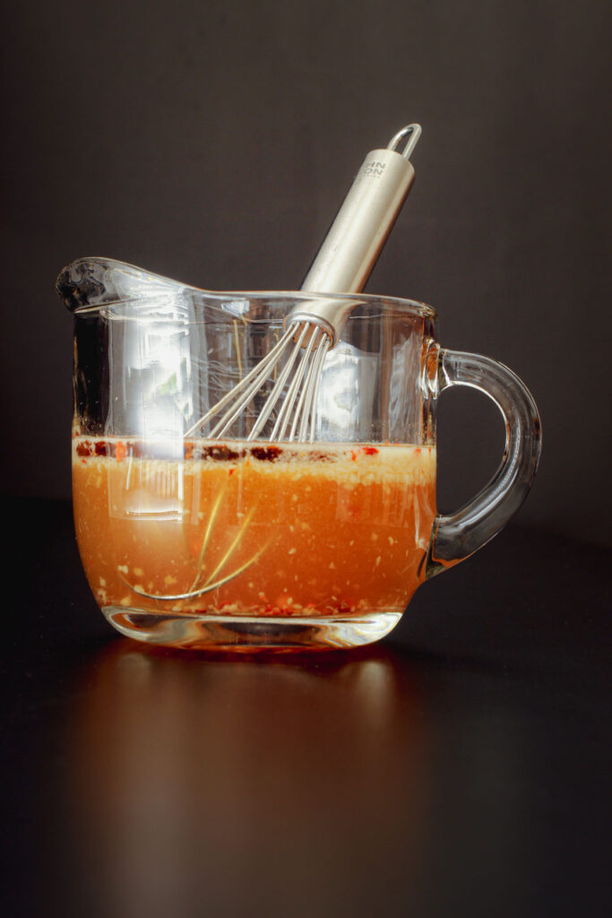 salad dressing whisked together in the pitcher.