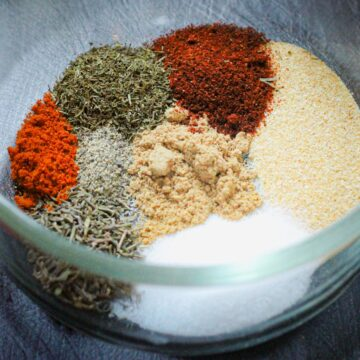 ingredients for fish seasoning in a small glass bowl.