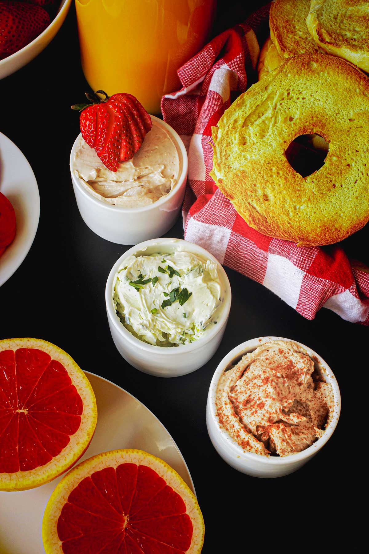 bagel buffet with small ramekins of flavored cream cheeses.