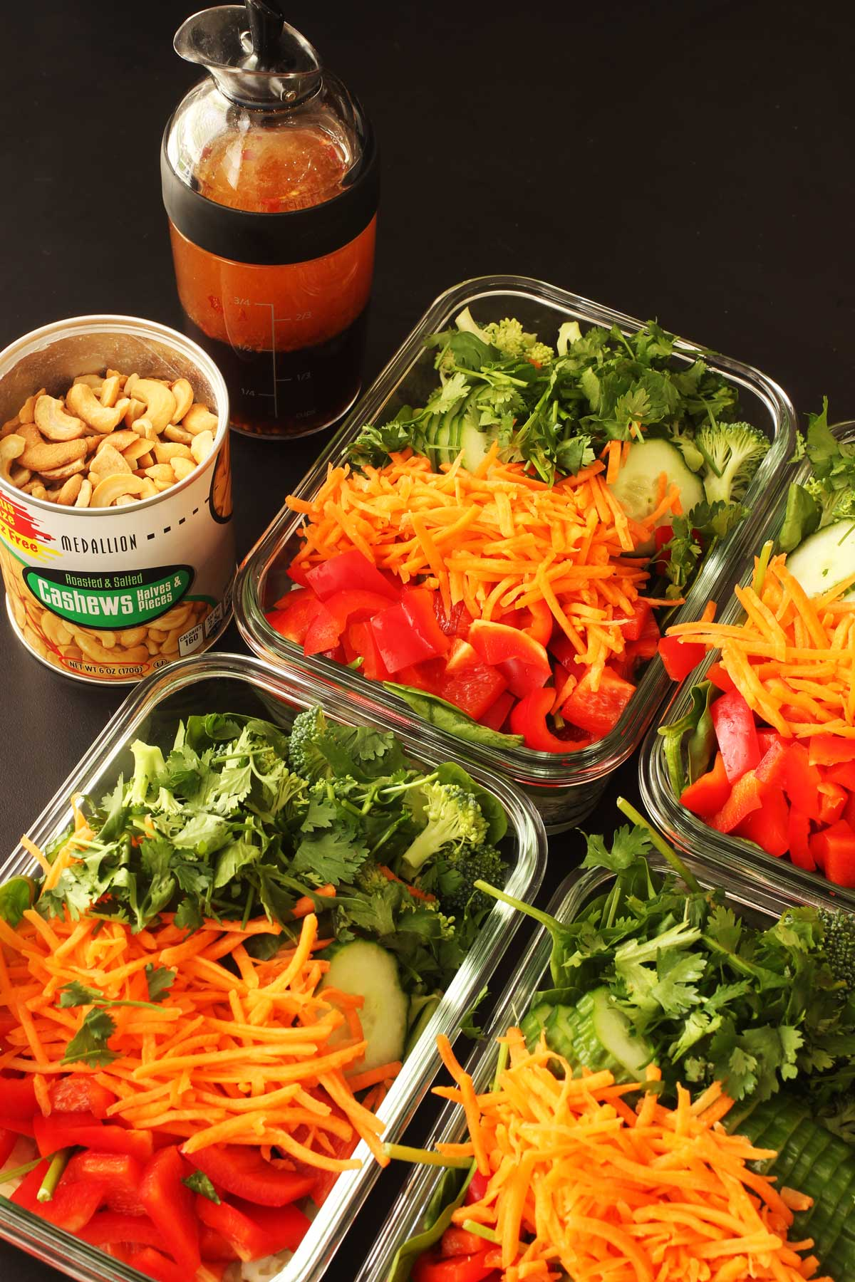 meal prep salads in glass dishes.
