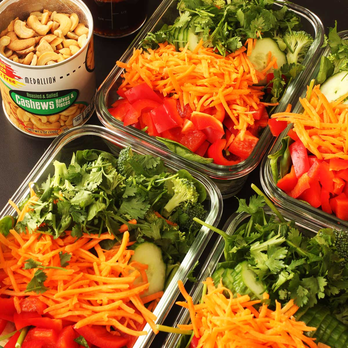 meal prep salads in glass rectangular dishes.