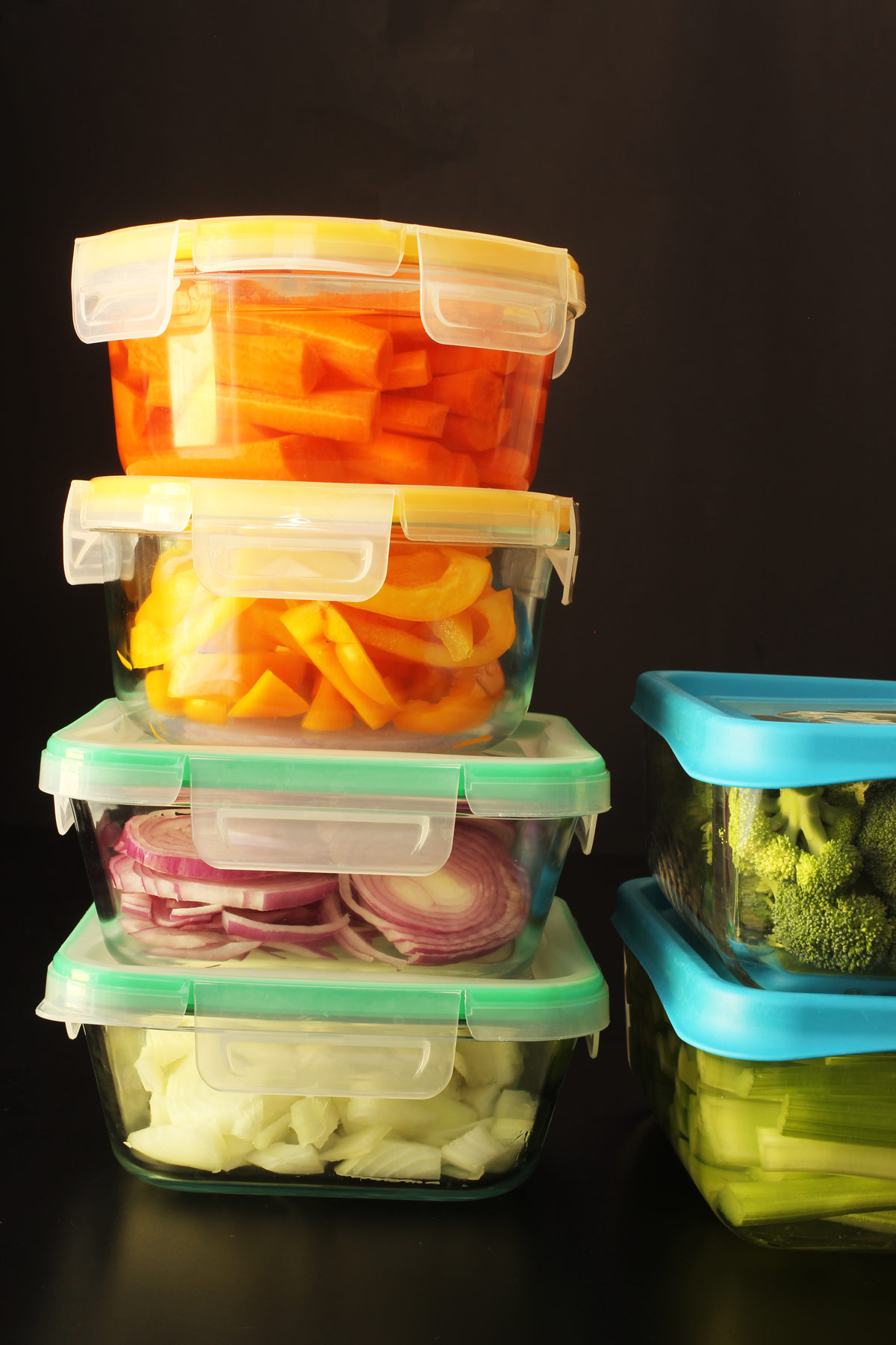 vegetables prepped in glass containers with lids.