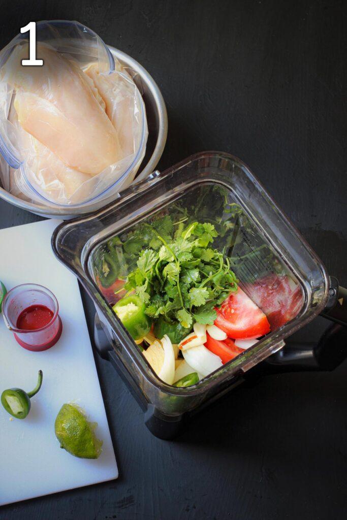 spicy chicken marinade ingredients in blender next to bag of chicken breast.