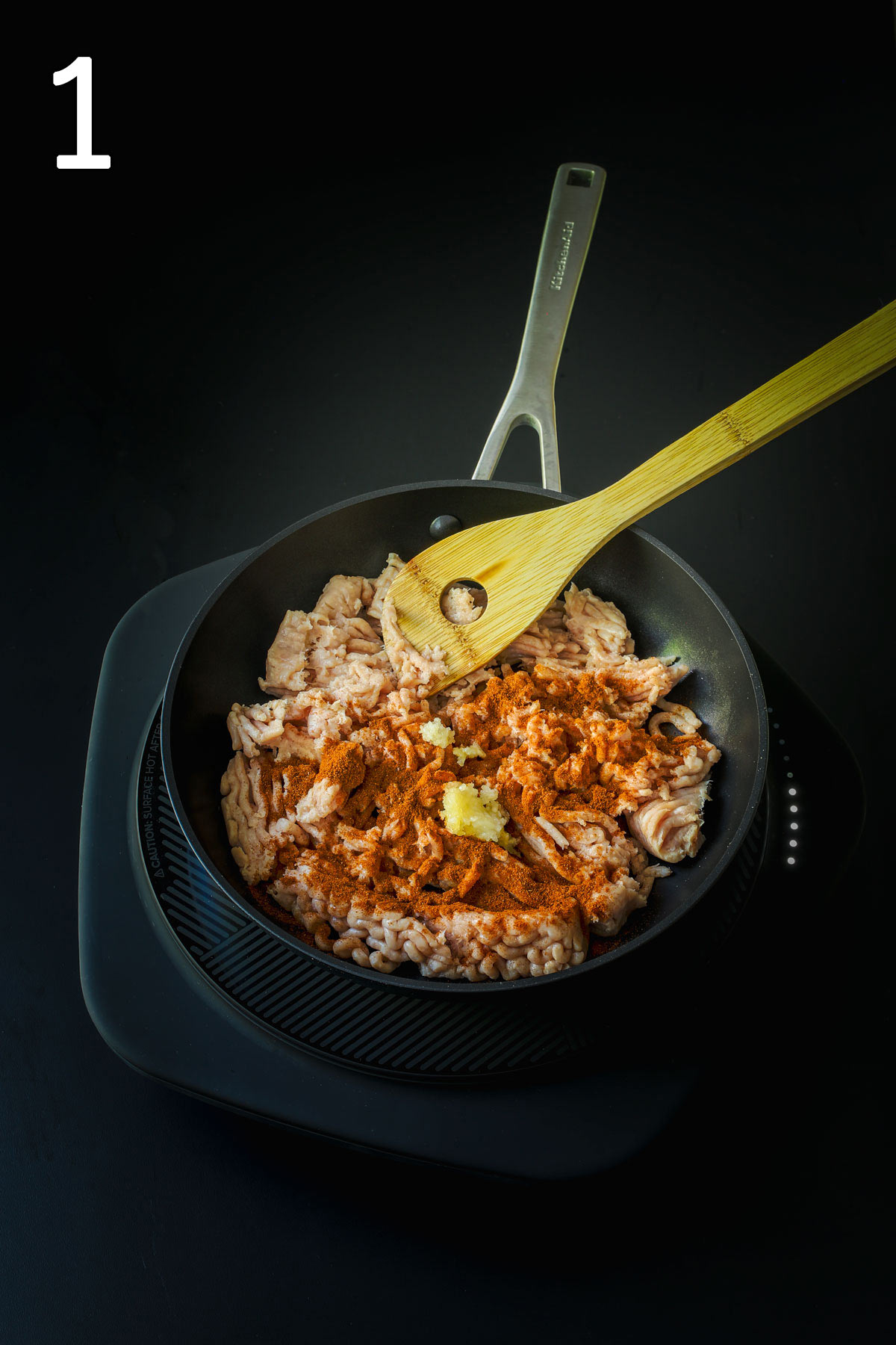 cooking turkey and spices in skillet.