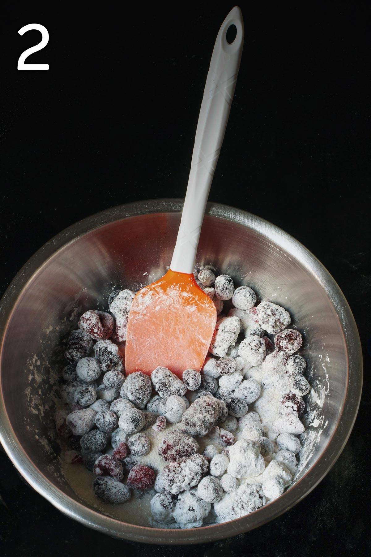 berries in bowl with sugar and cornstarch.