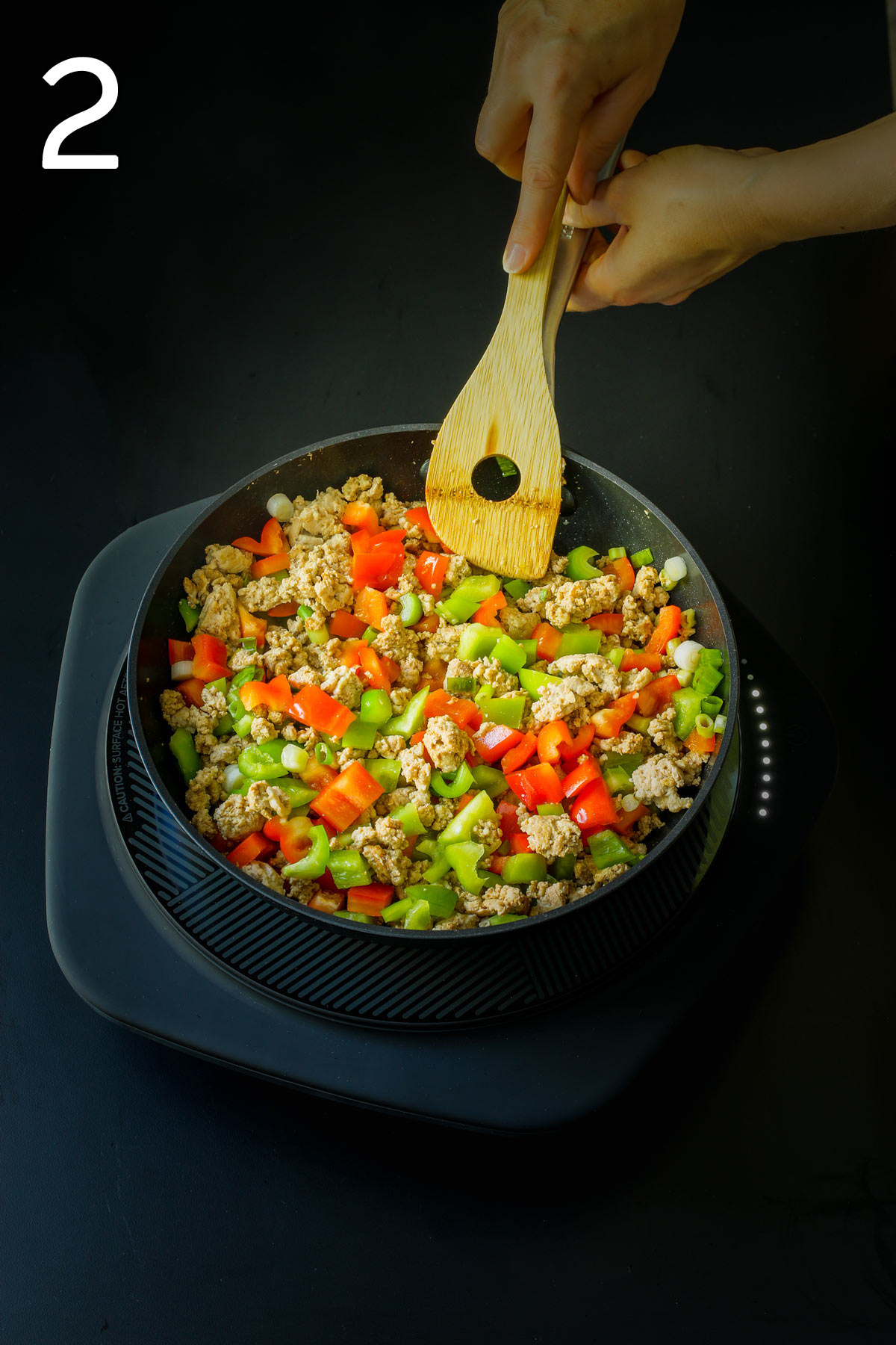 adding peppers and onions to skillet.