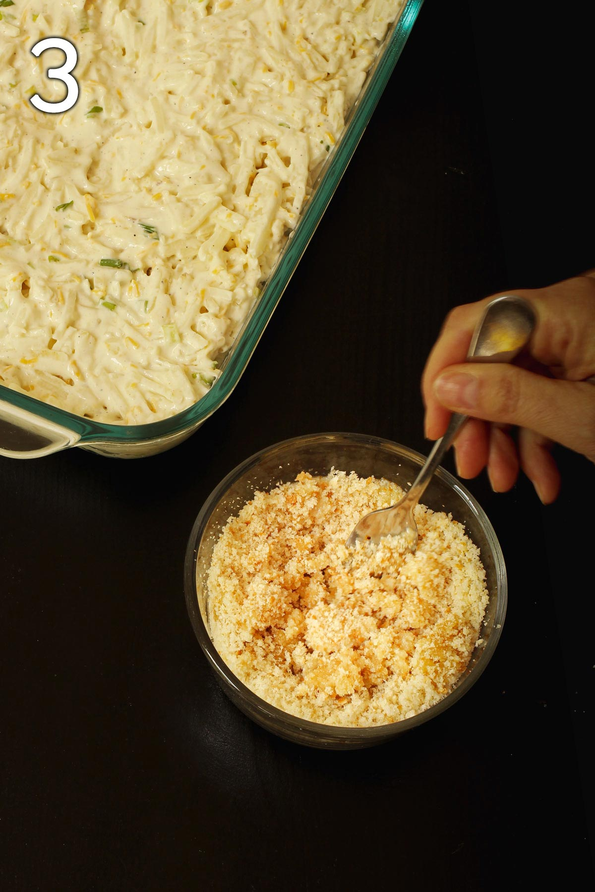 prepping the buttered bread crumbs in a small bowl.
