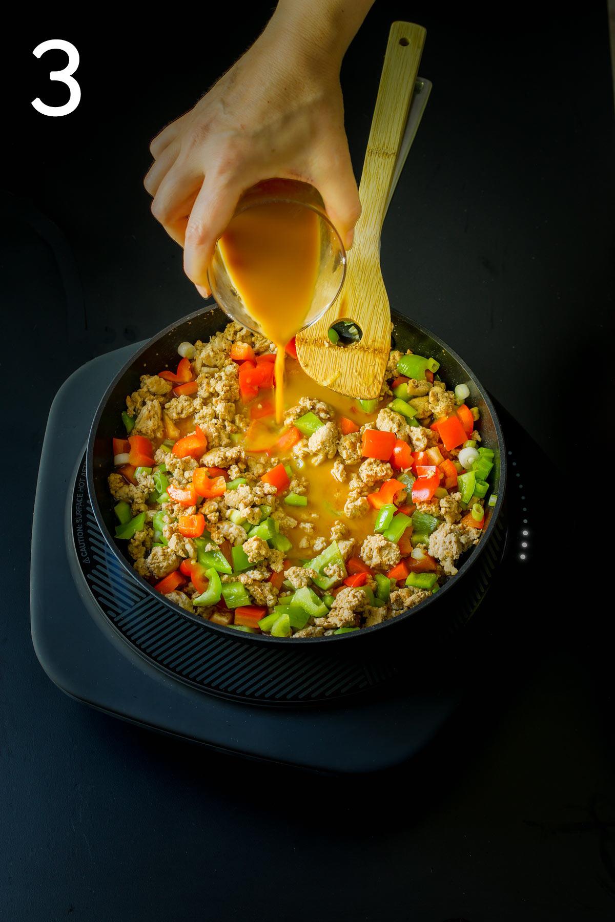 adding sauce ingredients to skillet.