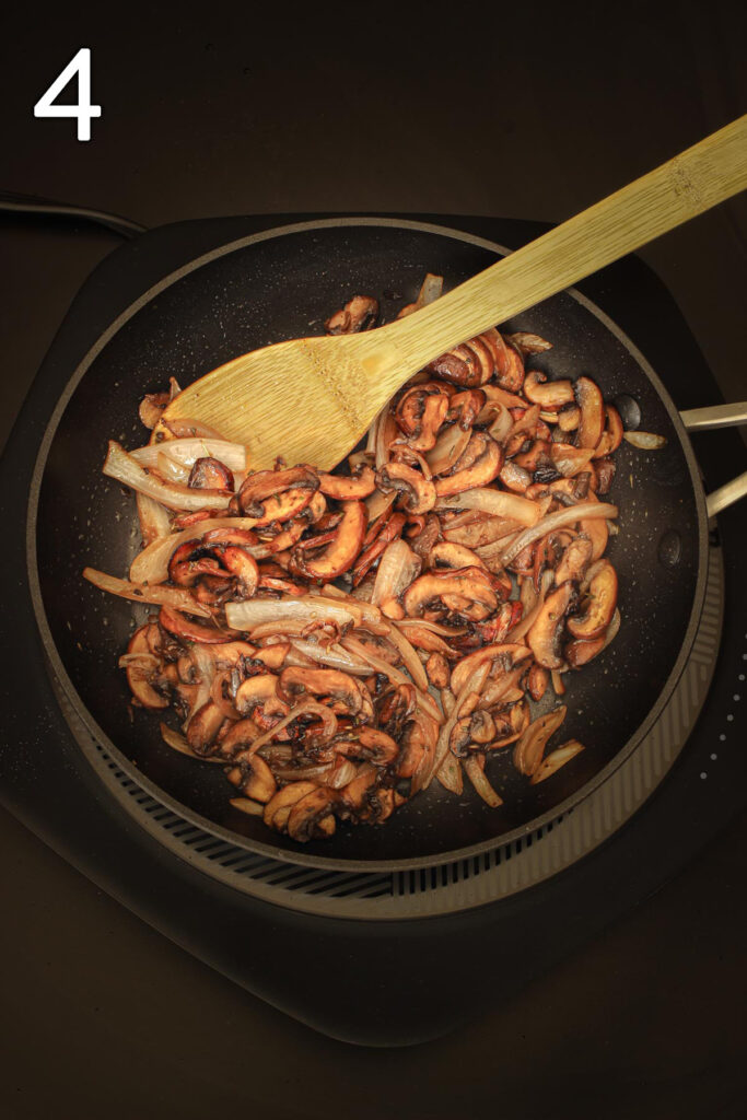 sautéed mushrooms and onions in the skillet seasoned with balsamic and herbs.