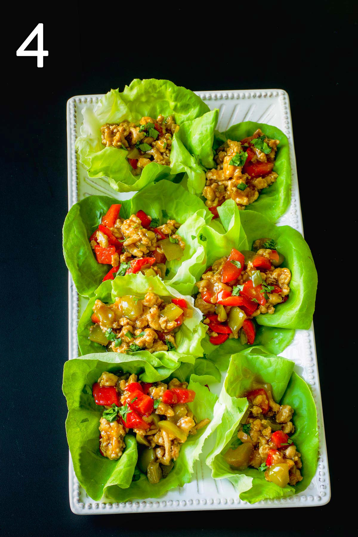 cooked filling served in lettuce cups on a large platter.