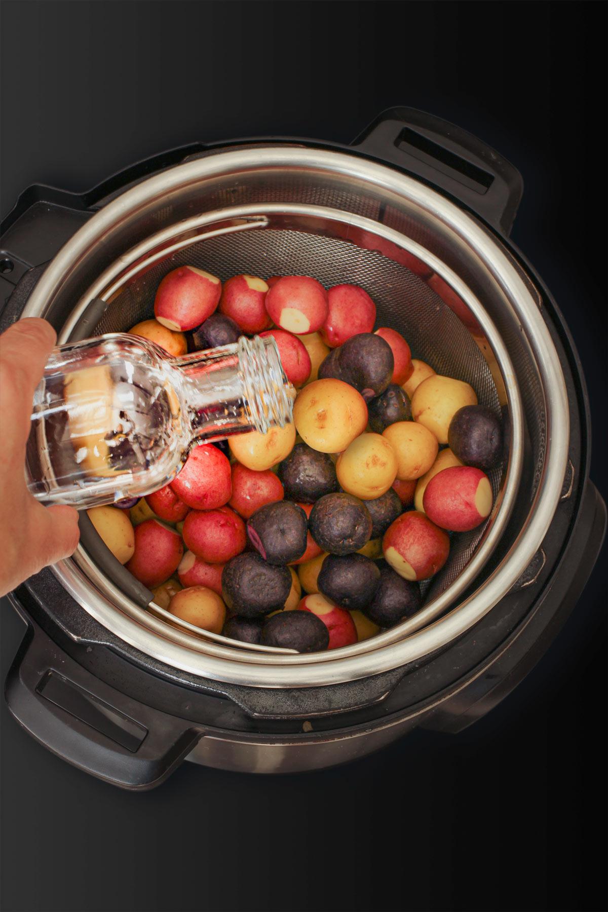 pouring water into potato pot.