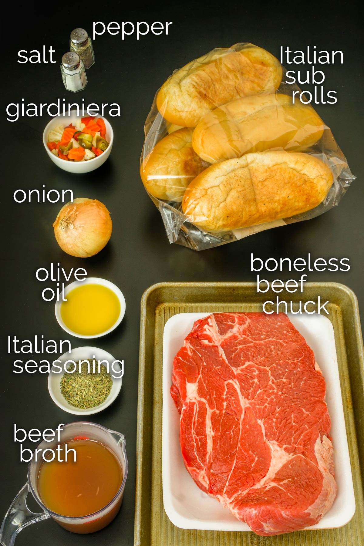 ingredients for instant pot italian beef on a black table top.