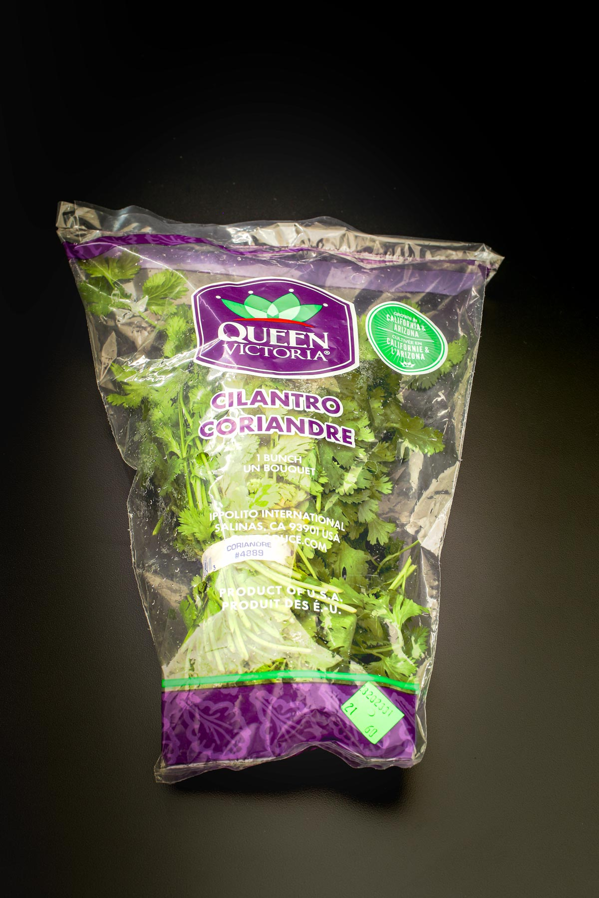 fresh bunch of cilantro in a perforated plastic bag.