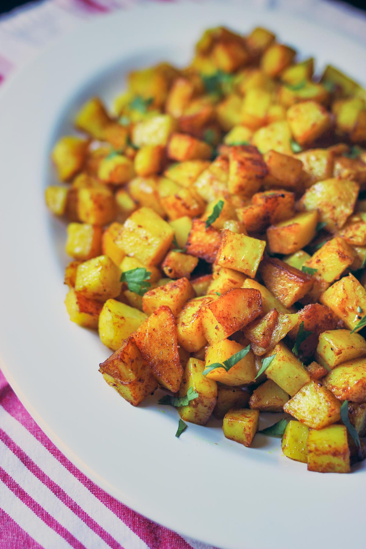 curried potatoes on a large oval white platter.