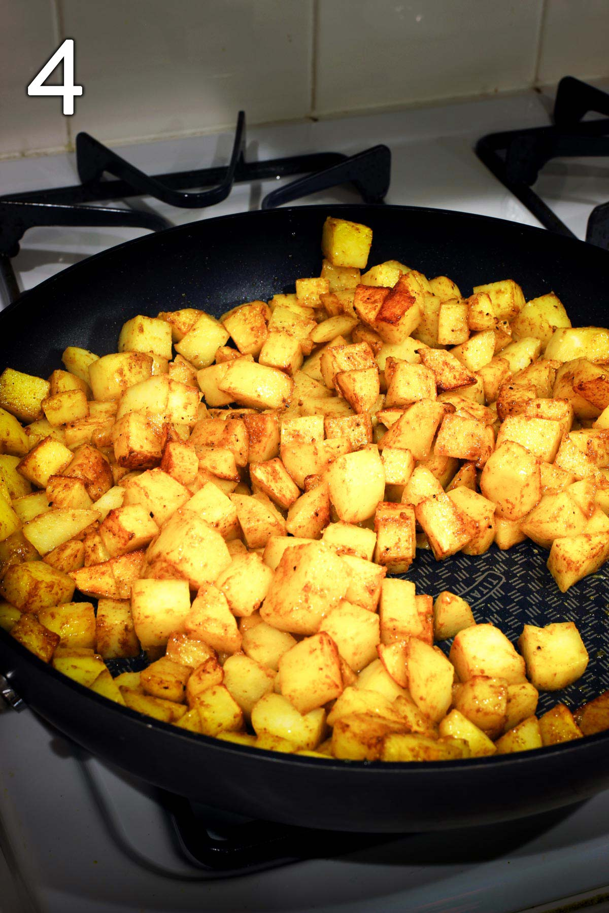 finished potatoes in open skillet.