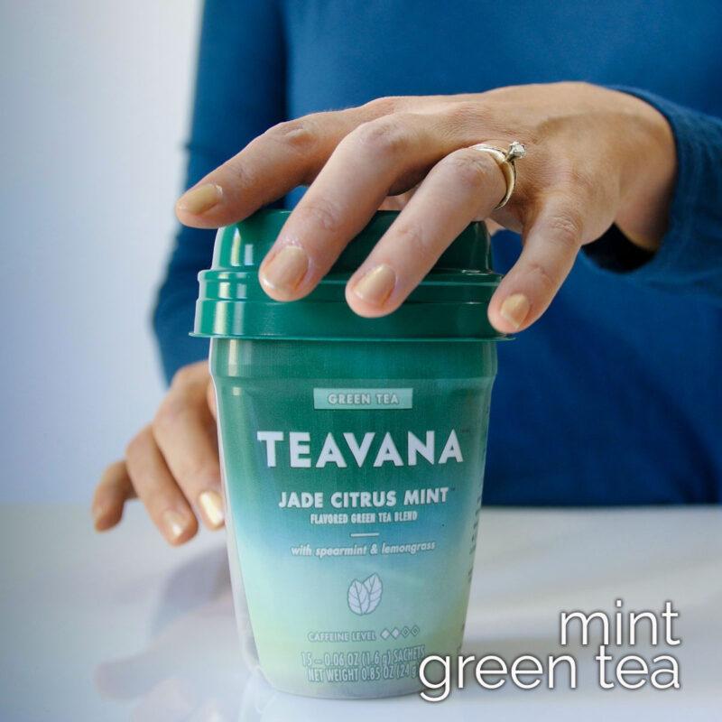 woman's hand on carton of teavana jade citrus mint tea.