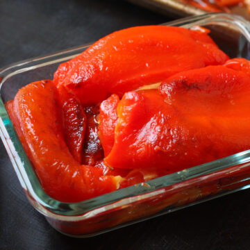 roasted red peppers in glass storage container.