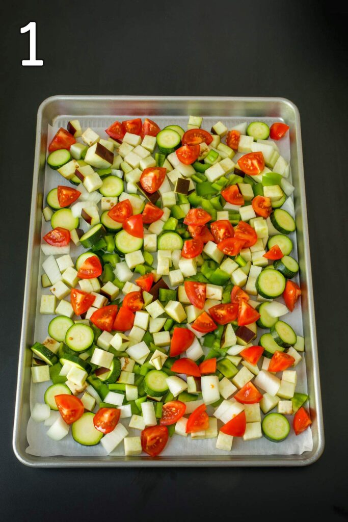 ratatouille vegetables chopped and spread on baking sheet.