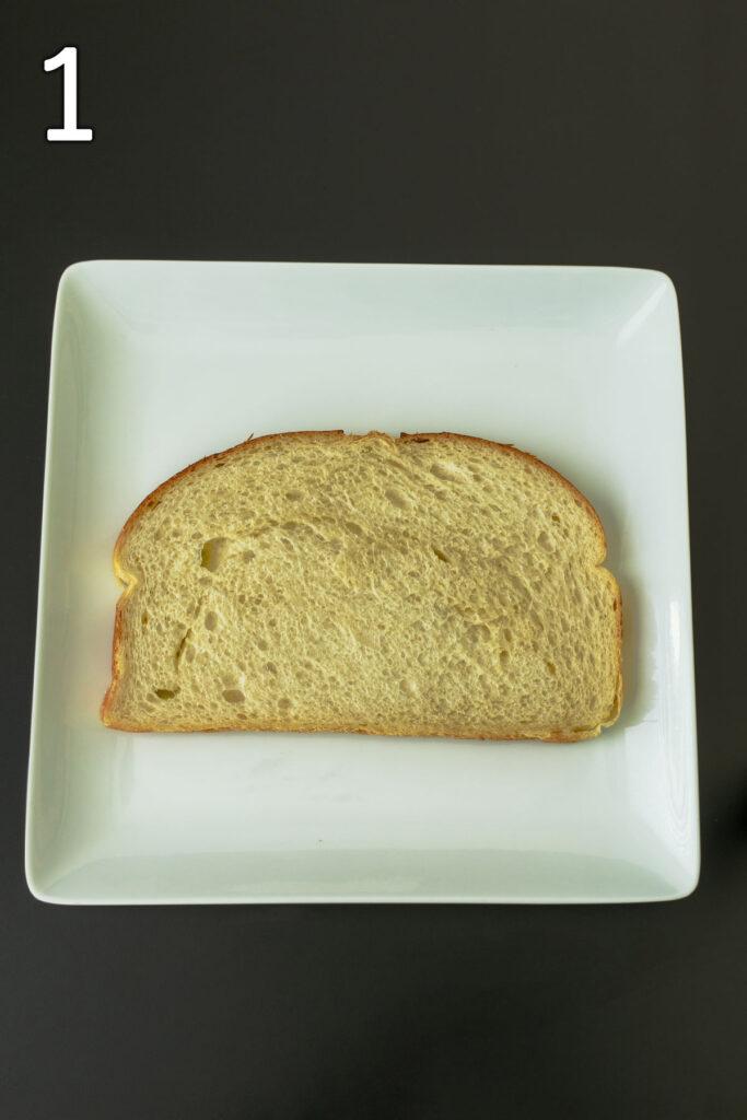 slice of toast on white plate.