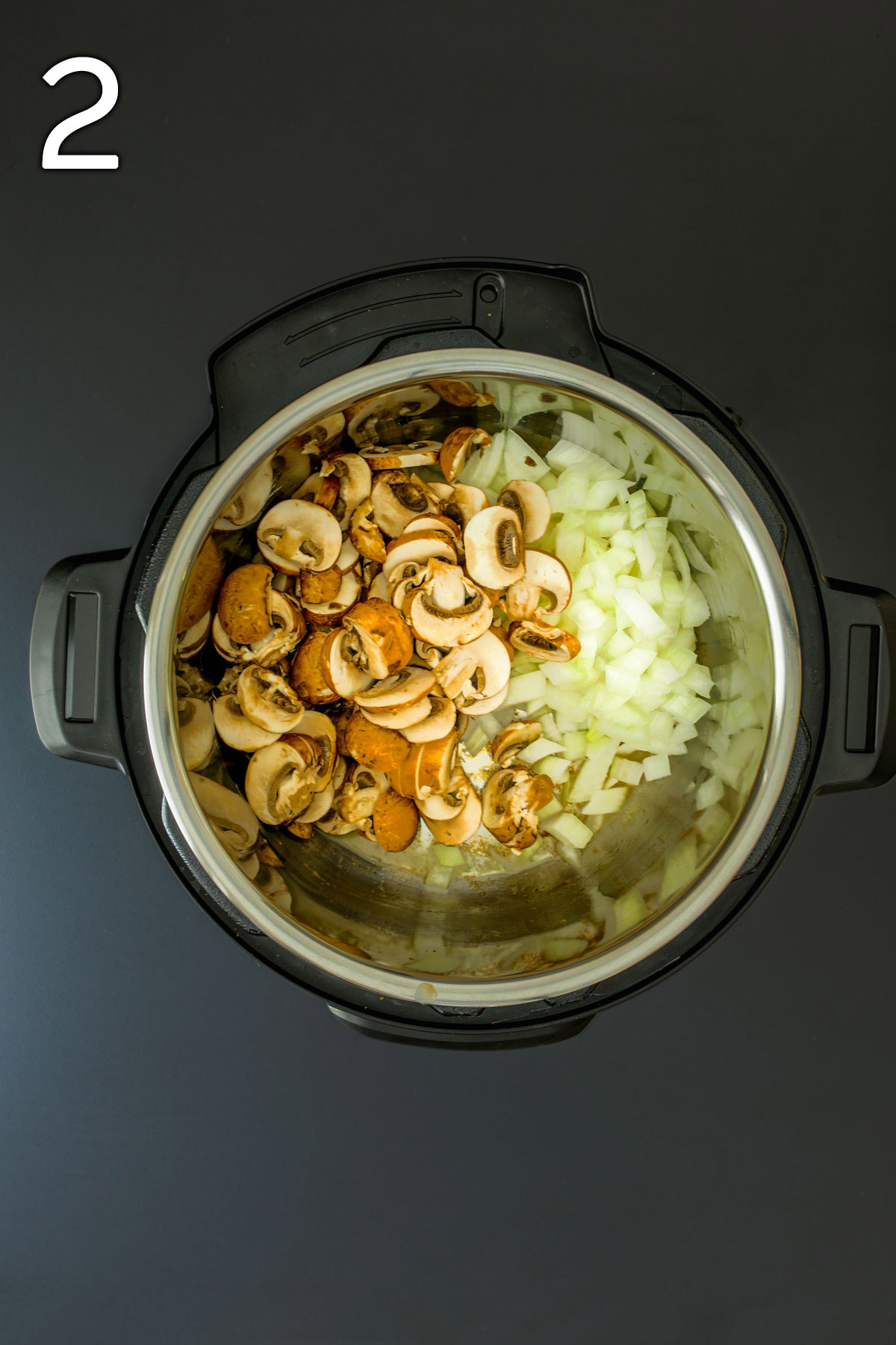sauteing mushrooms and onions in drippings in pot.