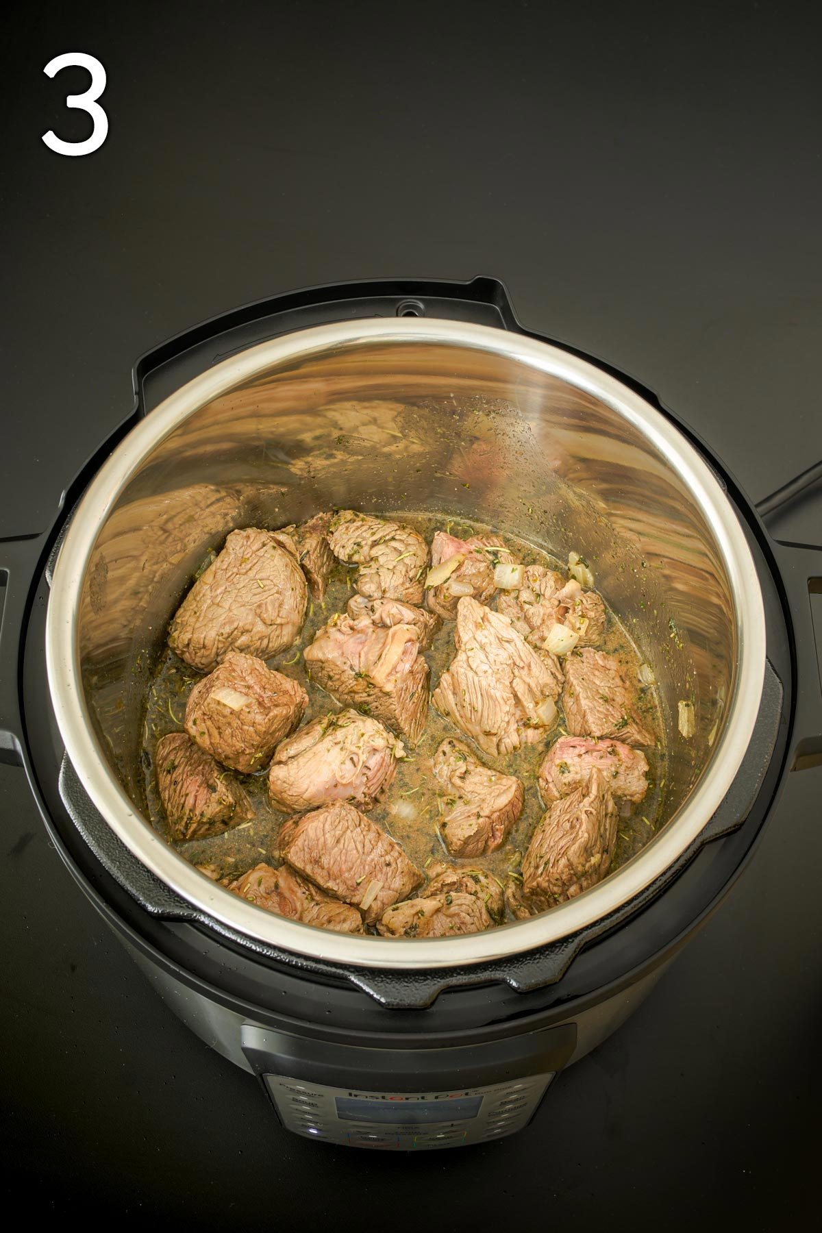meat ready to cook in pot.