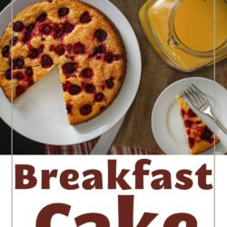 breakfast cake with wedges removed onto plates with a pitcher of orange juice on the breakfast table.