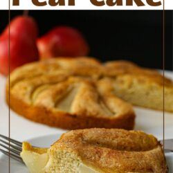 side view of slice of spiced pear cake on a white plate with a fork.