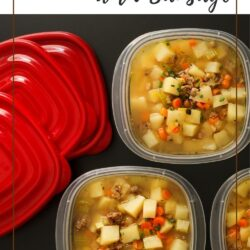 three meal prep containers holding soup next to three red lids.