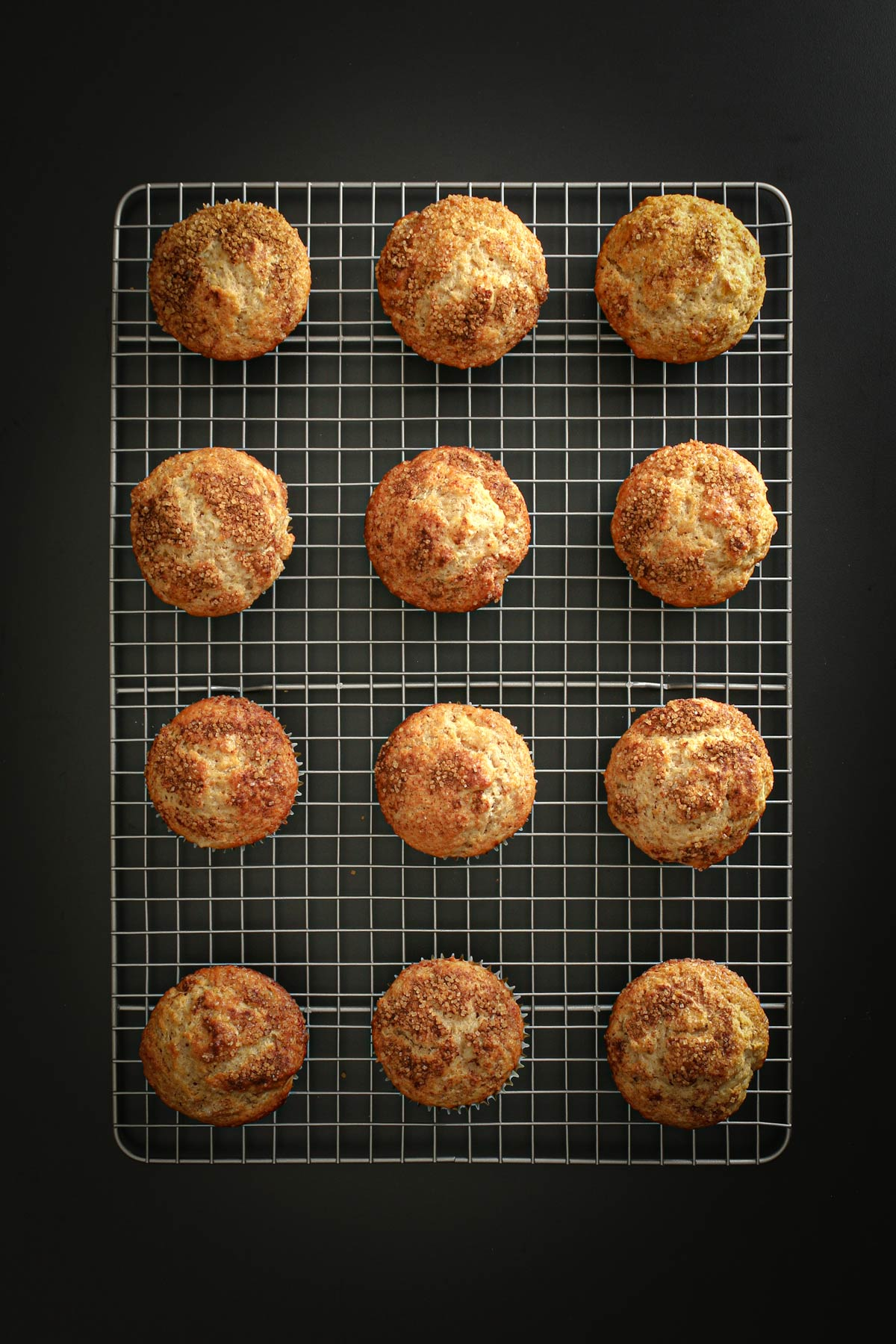 baked muffins cooling on gridded wire rack.