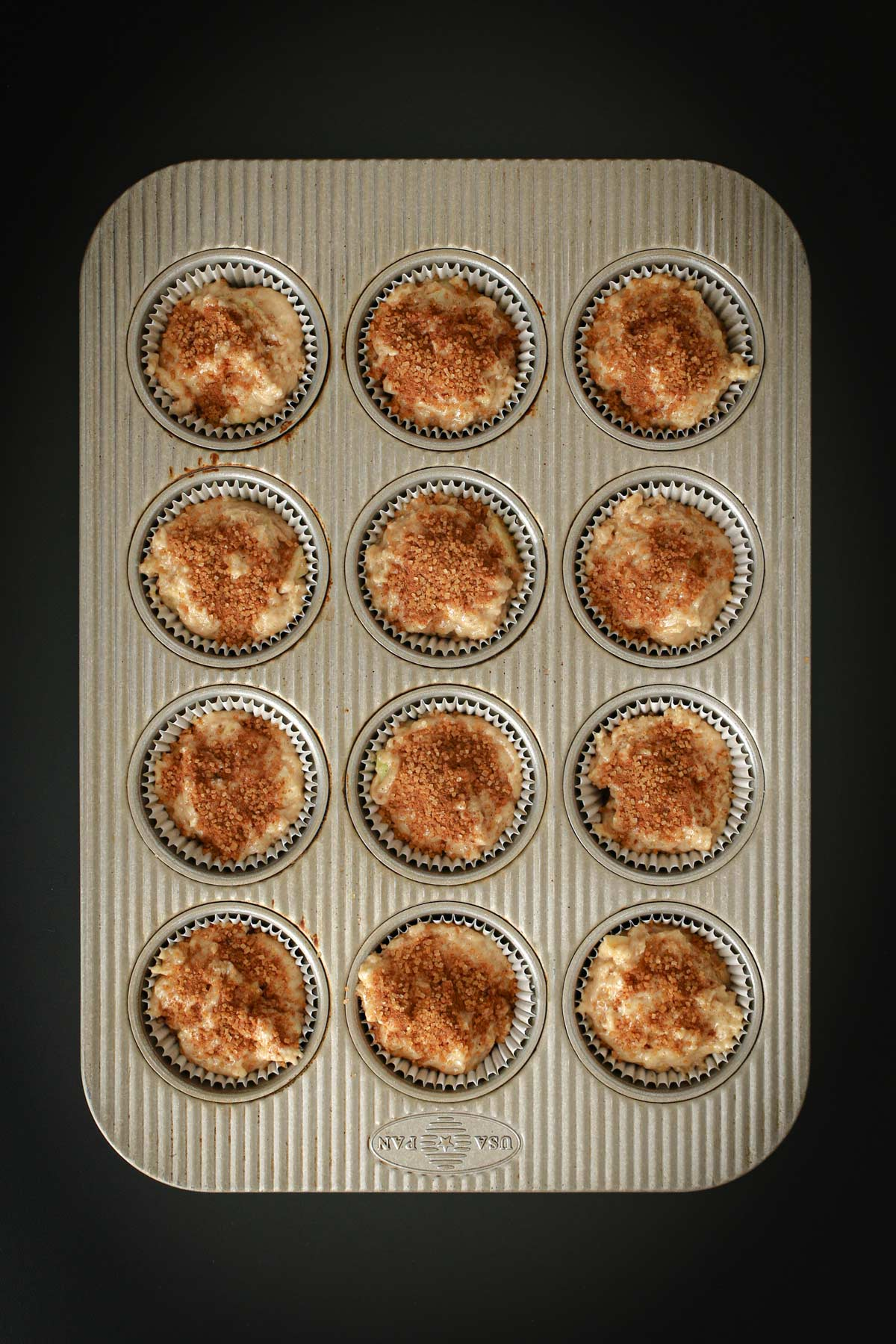 cinnamon sugar topping sprinkled generously atop the batter in each cup.