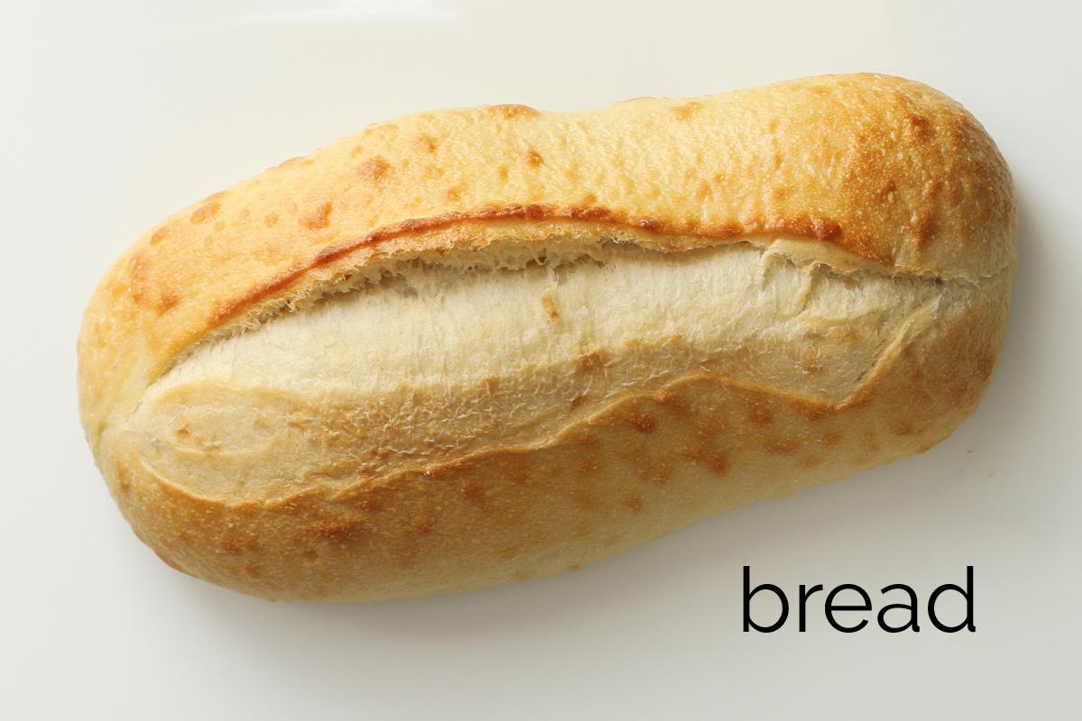 loaf of Italian bread on a white board.