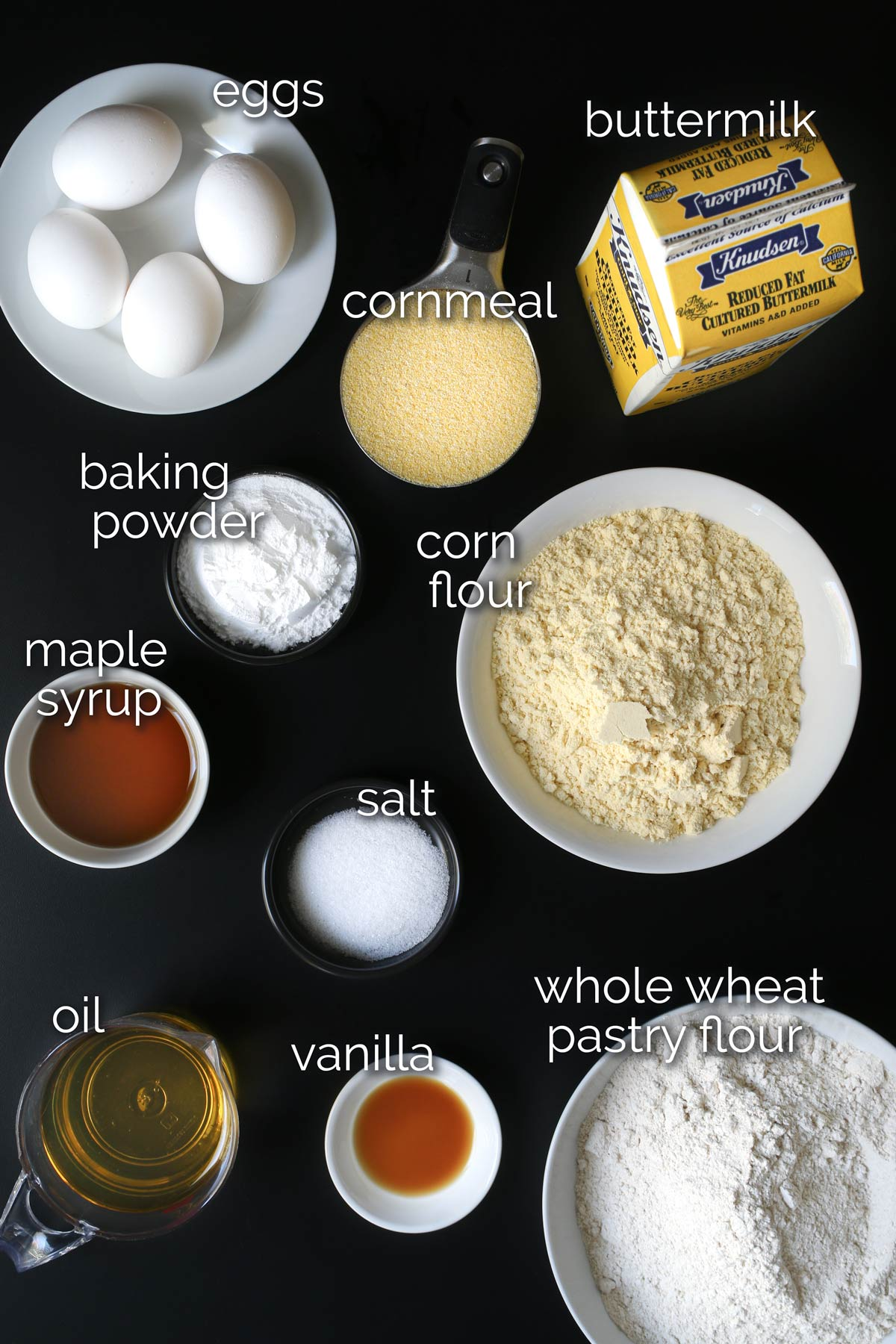 cornbread waffle ingredients laid out on table top.