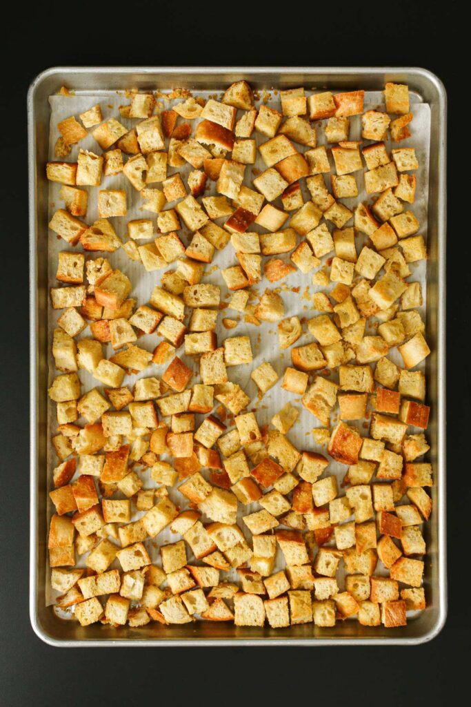 baked croutons golden brown on the sheet pan.