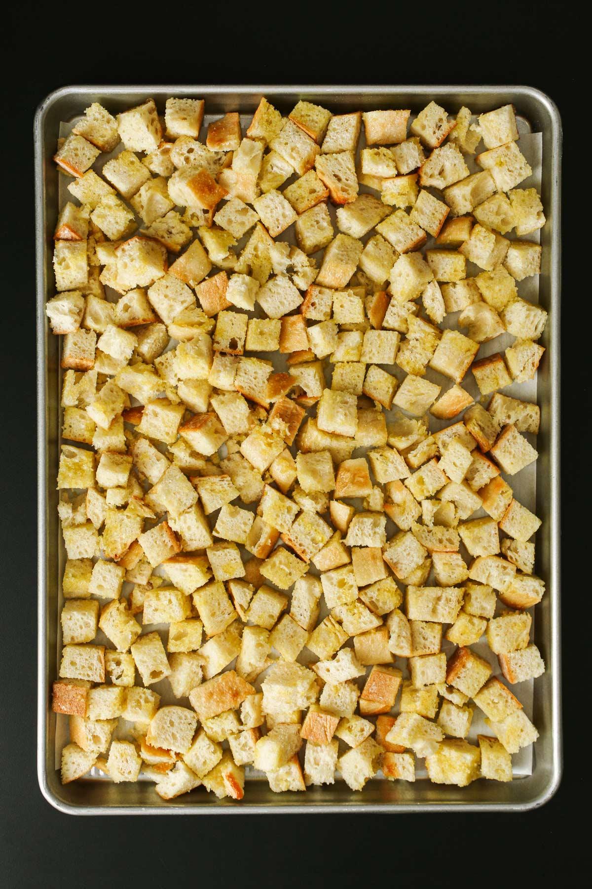 bread cubes on sheet pan.