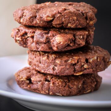 stack of double chocolate oatmeal cookies on white plate.