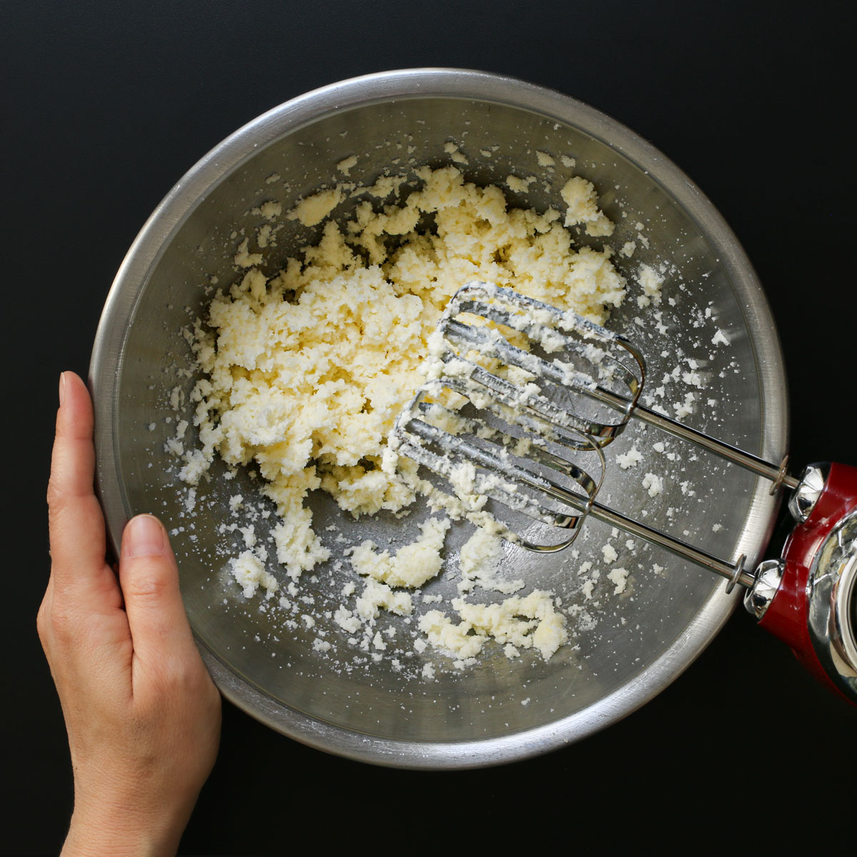 creamed butter and sugar in mixing bowl with mixer.