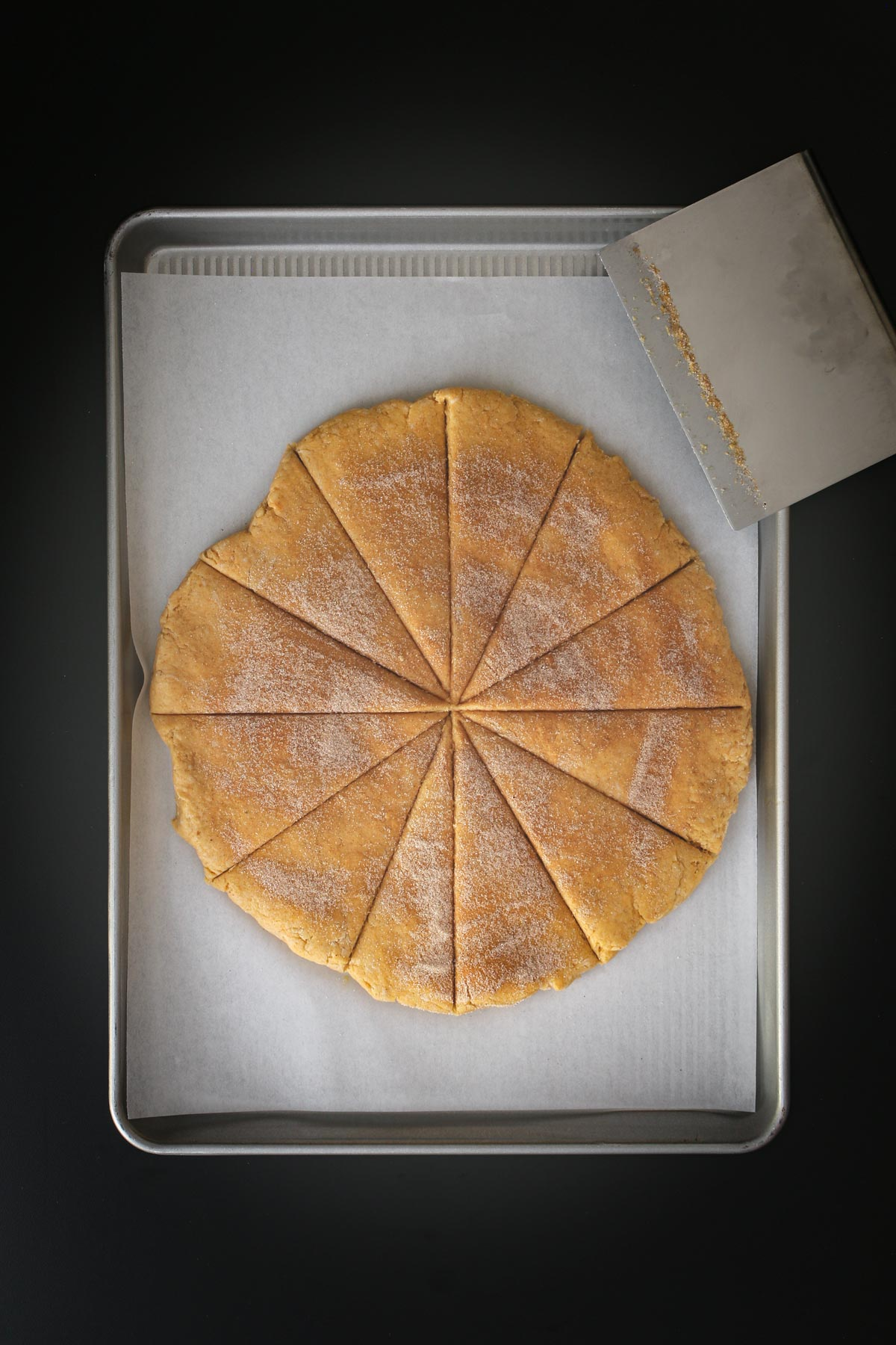 scone round cut into 12 triangles with dough knife.