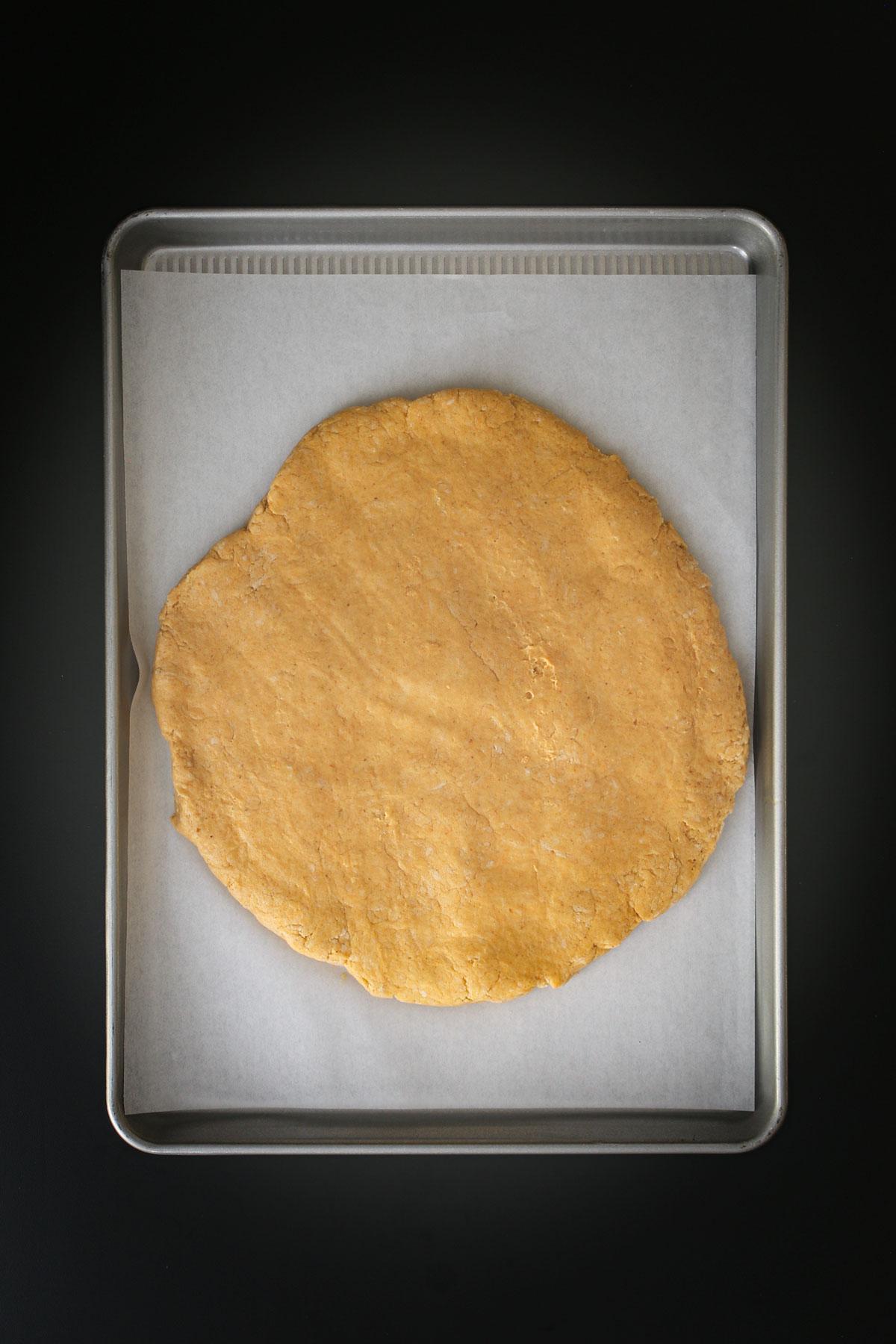 dough pat out into large circle on baking sheet.