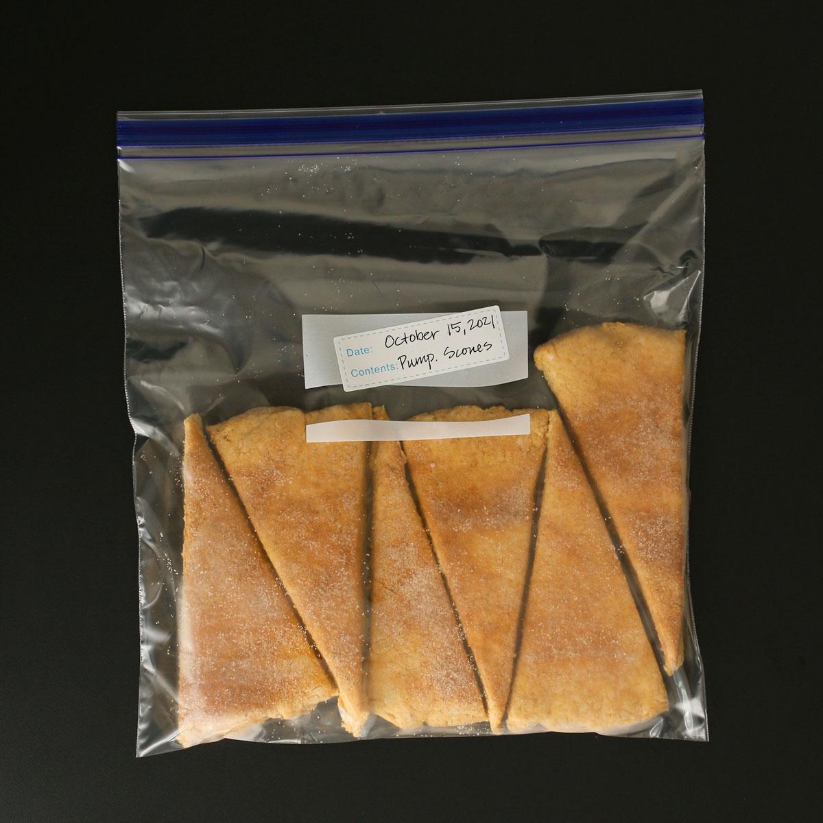 frozen pumpkin scones lined up in a ziptop freezer bag.