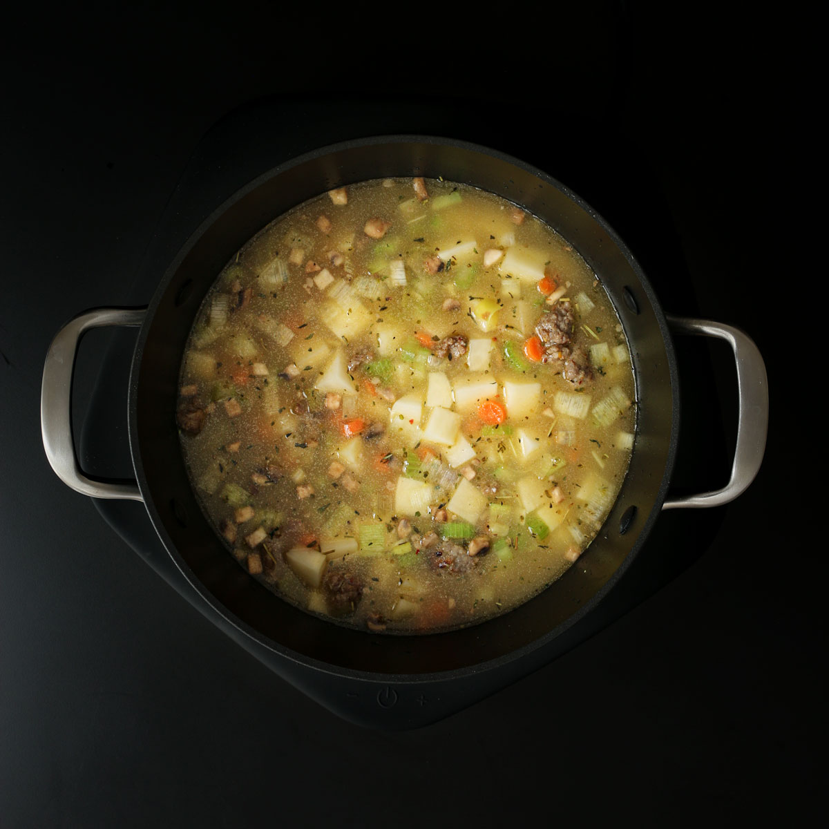 all the ingredients in the pot simmering.