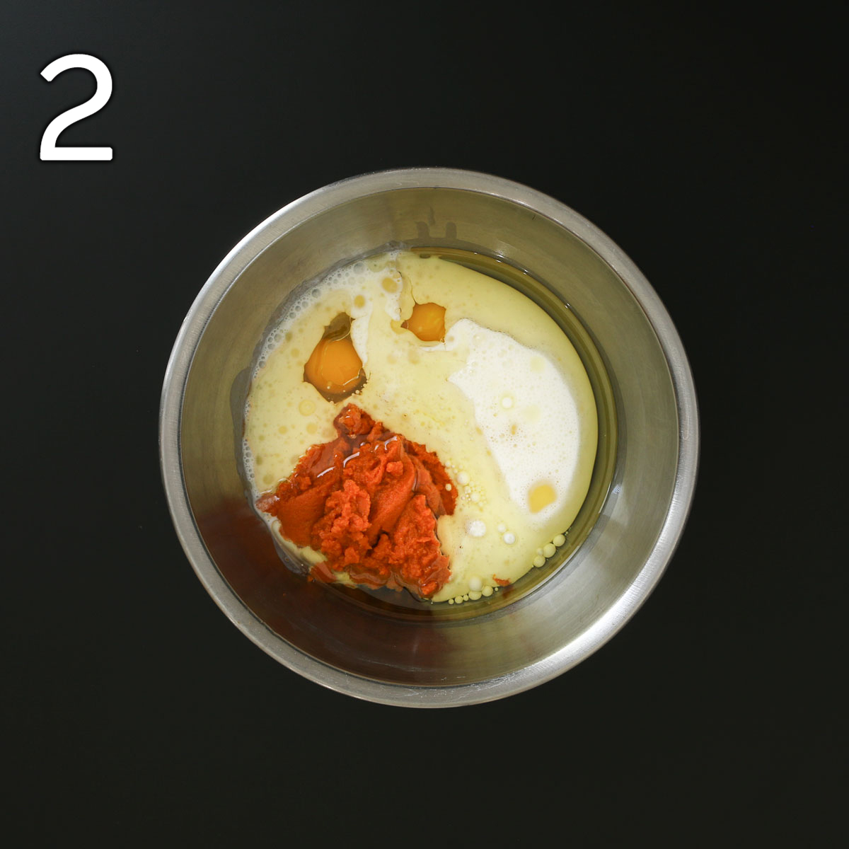 buttermilk, pumpkin, eggs, and oil in second metal mixing bowl.