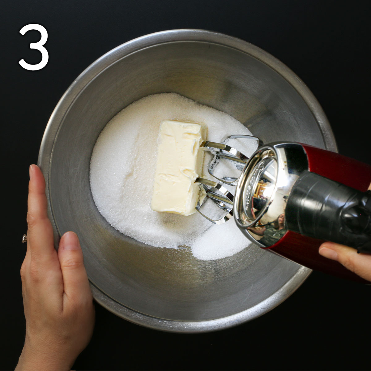 butter and sugar in a mixing bowl with hand mixer.