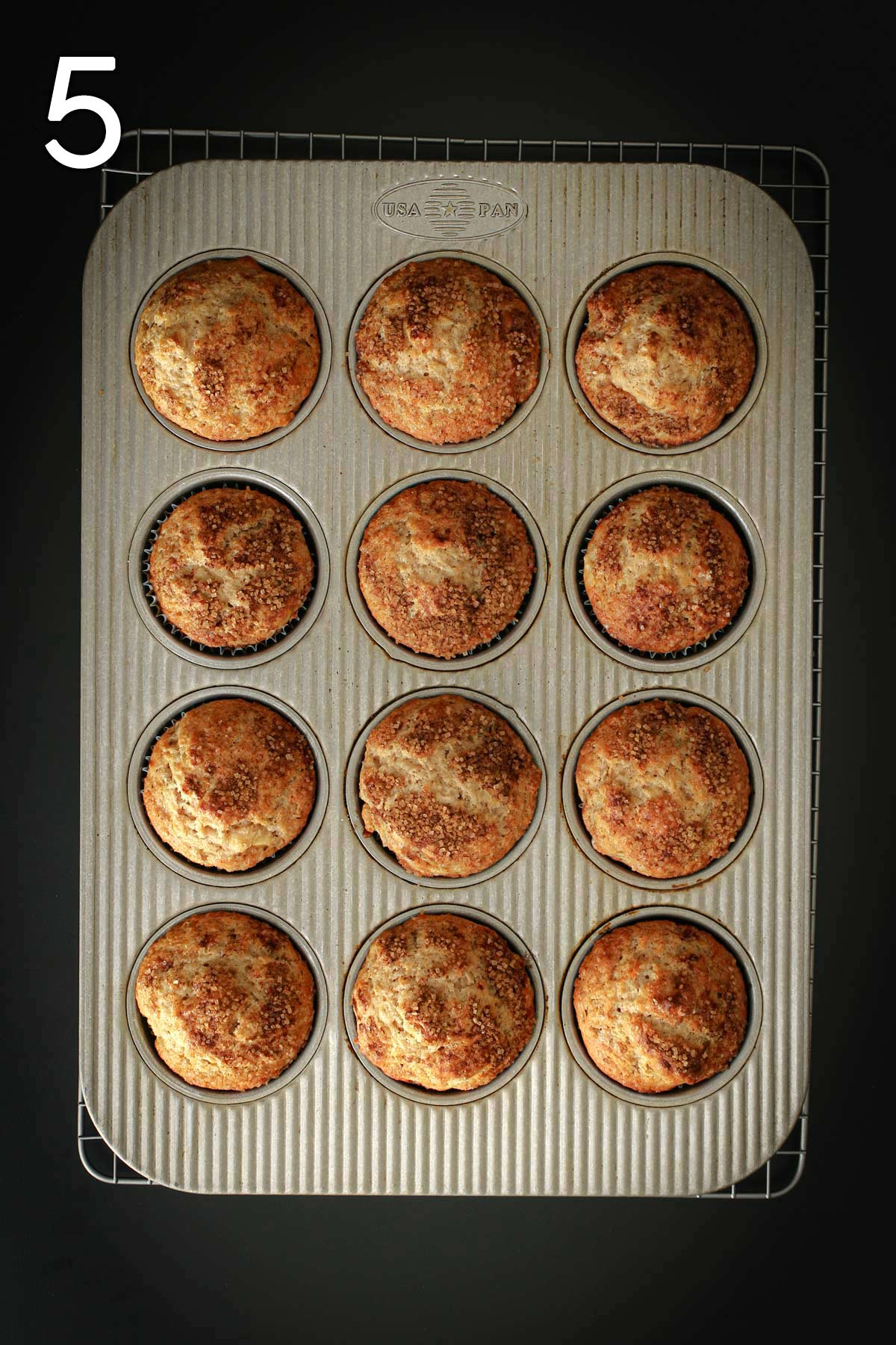 cinnamon apple muffins baked in muffin tin.