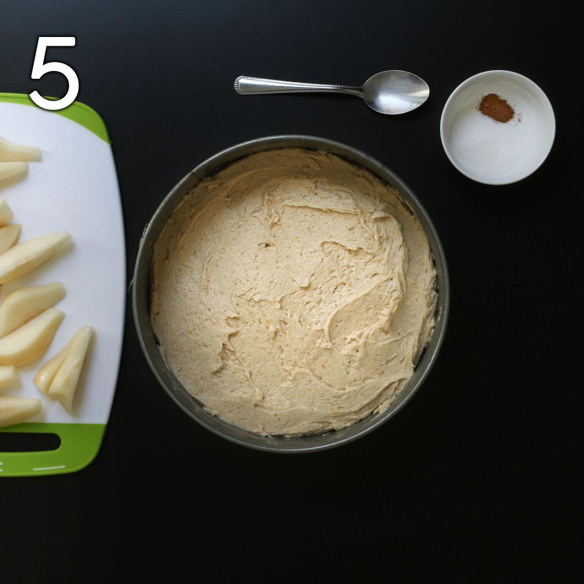 batter spread in cake pan.